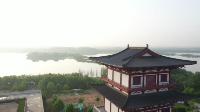ancient chinese temples on the lakeside - tradition stock videos & royalty-free footage