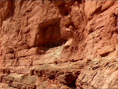 ancient cliff dwellings overlook the colorado river in the grand canyon. - cliff dwelling stock videos & royalty-free footage