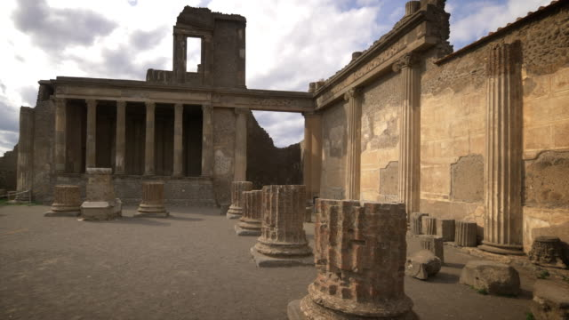 ancient columns and ruins of pompeii, italy. the city was destroyed by the eruption of mount vesuvius in 79ad. - roman stock videos and b-roll footage