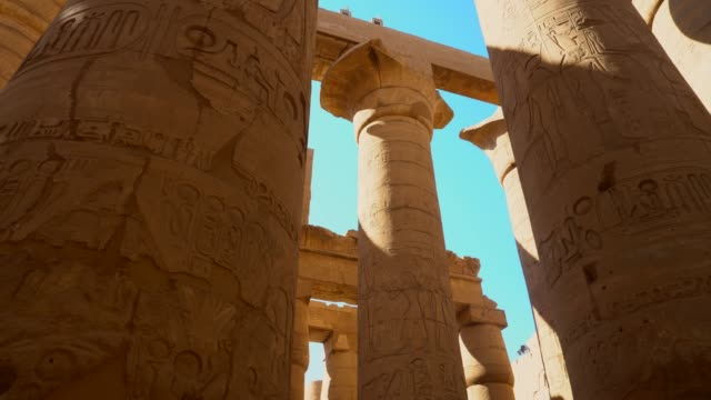 ancient columns of karnak temple in luxor. egypt - ancient history stock videos & royalty-free footage