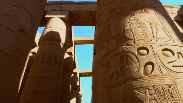 ancient columns of karnak temple in luxor. egypt - old ruin stock videos & royalty-free footage