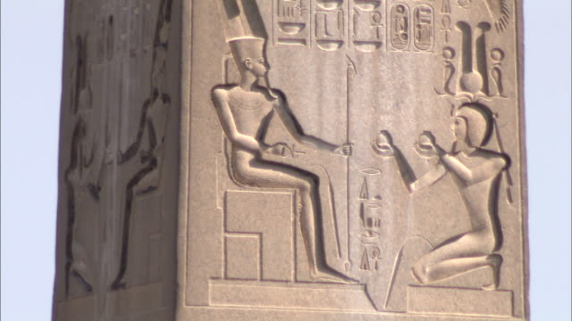 ancient egyptian characters and hieroglyphics are carved on a stone structure. - engraved image stock videos & royalty-free footage