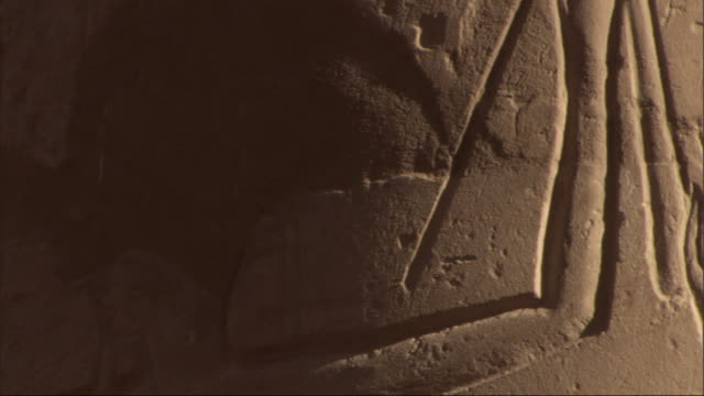 ancient egyptian hieroglyphics and drawings cover a stone wall. - hieroglyph stock videos & royalty-free footage