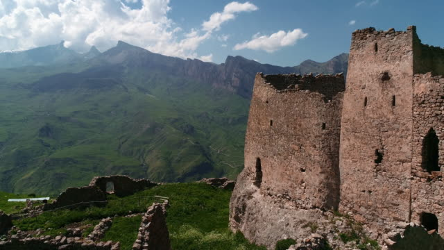 ancient fortress and tower in the mountains of north ossetia. alania, northern caucasus - temple building stock videos & royalty-free footage