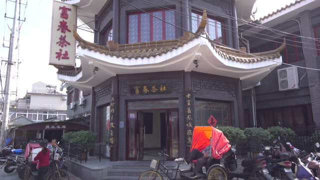 ancient fuchun teahouse in a traditional residential quarter in yangzhou fuchun teahouse still keeps the old styles in architecture and food to enjoy... - chinese tea cup stock videos and b-roll footage