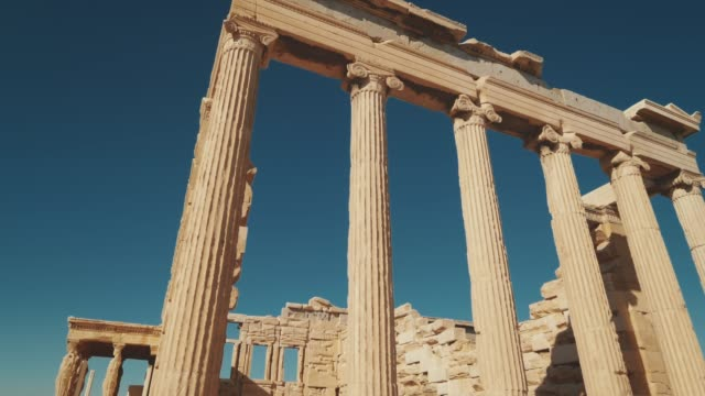 ancient greek temple ruins of erechtheion at the acropolis in athens, greece - athens greece stock videos & royalty-free footage