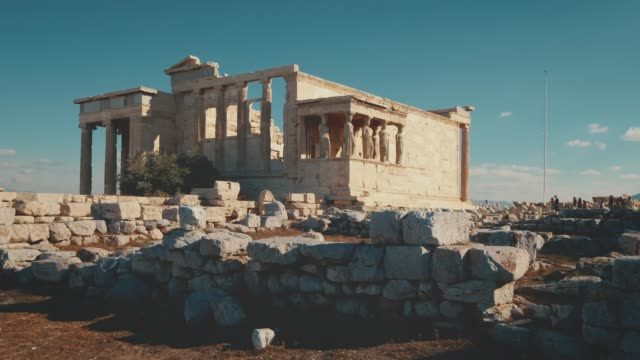 ancient greek temple ruins of erechtheion near the acropolis in athens, greece - acropolis athens stock videos & royalty-free footage