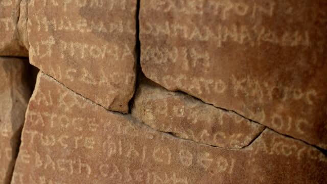 ancient greek writing carved onto egyptian monument - 墓石点の映像素材/bロール