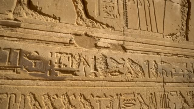 ancient hieroglyphics of edfu temple in luxor. egypt - old ruin stock videos & royalty-free footage