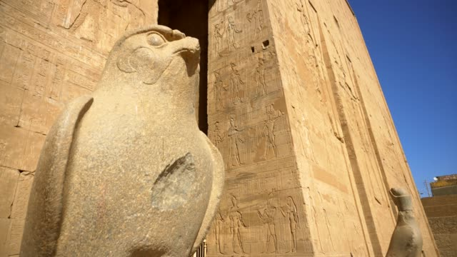 ancient horus of edfu temple in luxor. egypt - stone material stock videos & royalty-free footage