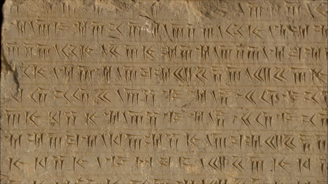 CU TD Ancient inscription in stone, Persepolis, Iran