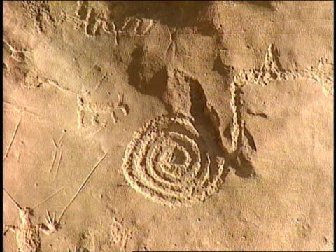 ancient pueblo petroglyphs depict animals and symbols. - pueblo bonito stock videos & royalty-free footage
