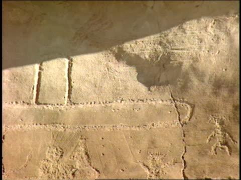 ancient pueblo petroglyphs depict animals, people and symbols. - pueblo bonito stock videos & royalty-free footage