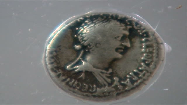 ancient roman cleopatra coin discovered newcastle upon tyne newcastle university ancient roman silver coin depicting queen cleopatra on display in... - cleopatra stock videos & royalty-free footage
