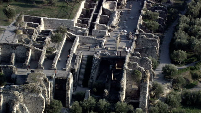 ancient roman ruins on sirmione  - aerial view - lombardy, provincia di brescia, sirmione, italy - grotte stock videos and b-roll footage