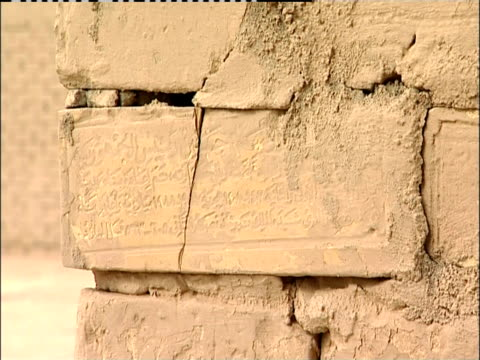 ancient script is carved into a cornerstone of an old building. - babylon stock videos and b-roll footage