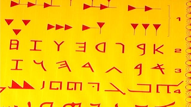 ancient scripts. tilt down on syriac, phoenician, and cuneiform scripts. - 足根点の映像素材/bロール