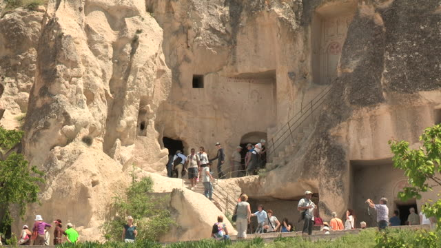 ancient stairs and tourists, cappadocia, turkey - cliff dwelling stock videos & royalty-free footage