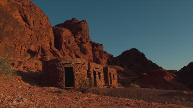 t/l ms ancient stone cabins and rocks in valley of fire state park, night to day, nevada, usa - puebloan peoples stock videos & royalty-free footage
