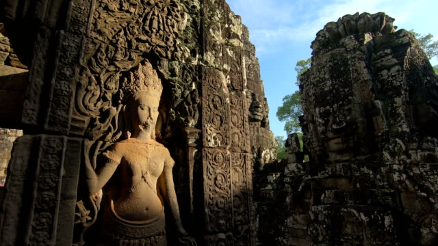 ancient stone faces bayon temple, angkor wat, siam reap, cambodia - unesco world heritage site stock videos & royalty-free footage