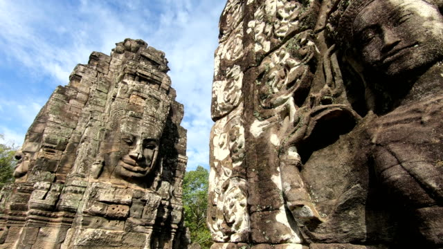 ancient stone faces bayon temple, angkor wat, siam reap, cambodia - monument stock videos & royalty-free footage