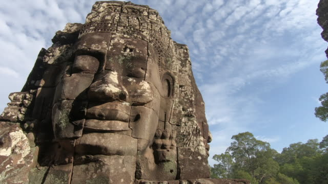 ancient stone faces bayon temple, angkor wat, siam reap, cambodia - famous place stock videos & royalty-free footage