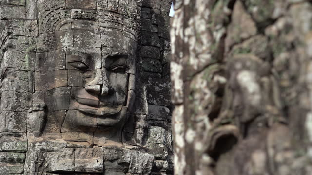 ancient stone faces bayon temple, angkor wat, siam reap, cambodia - temple building stock videos & royalty-free footage