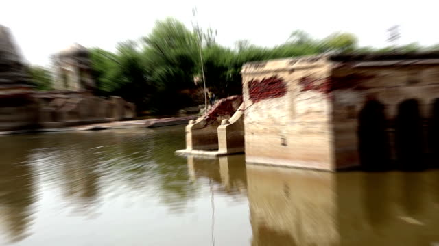 ancient temple near pond - temple building stock videos & royalty-free footage