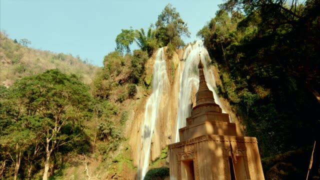 ancient temple near waterfall - myanmar stock videos & royalty-free footage
