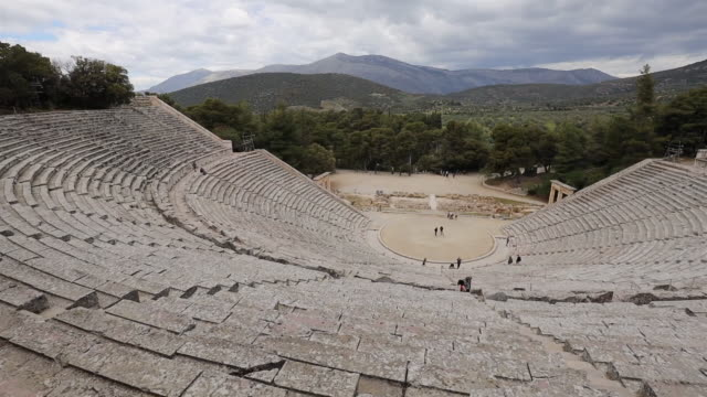 ancient theatre of epidaurus , old ruins of amphitheater - argolis / peloponnes, greece - sanctuary city stock videos & royalty-free footage