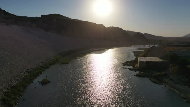 vidéos et rushes de ancient town of hasankeyf is seen by the tigris river, which will be significantly submerged by the ilisu dam on october 01, 2019 in hasankeyf,... - turquie