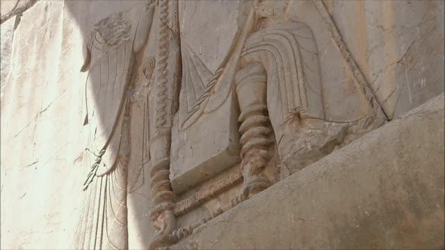 cu la tu ancient wall with bas relief, persepolis, iran - bas relief stock videos & royalty-free footage
