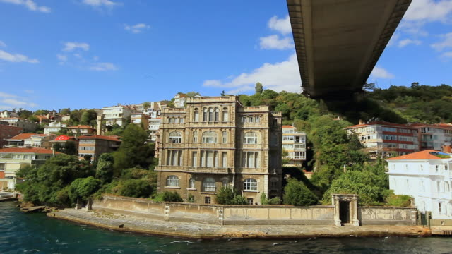 ds ancient water front building under the bosphorus bridge / istanbul, turkey - july 15 martyrs' bridge stock videos & royalty-free footage