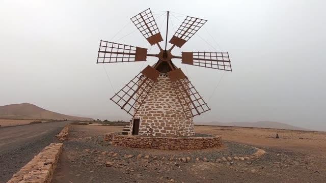 ancient windmill in fuerteventura - spain stock videos & royalty-free footage
