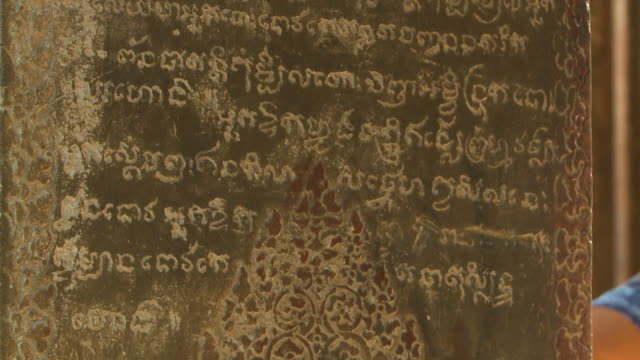 ancient writings on a wall - stone object stock videos & royalty-free footage