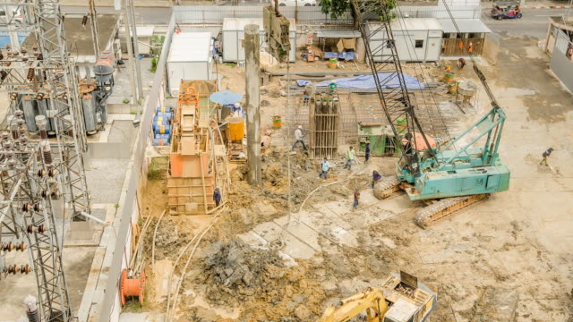 tl and aerial view : crane truck is built hole of base building - construction vehicle stock videos & royalty-free footage