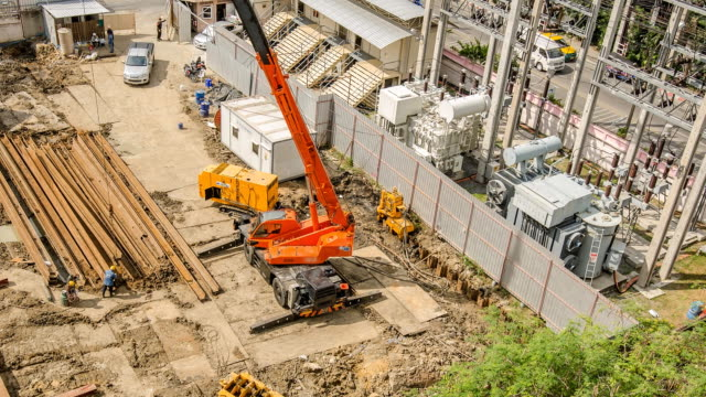 tl and aerial view : crane truck is built steel stake - construction vehicle stock videos & royalty-free footage