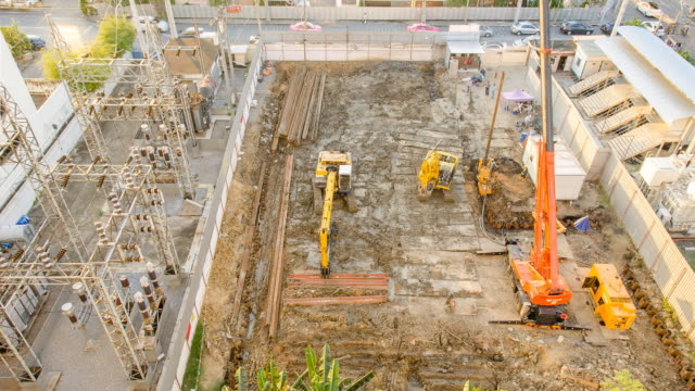 tl and aerial view : making foundation pile by tall crane - pile driver stock videos and b-roll footage