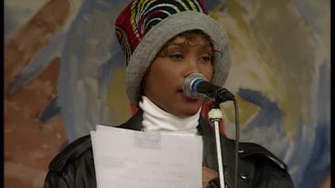 and aids victims marching through london in support of sufferers. contains exteriors of people making speeches on stage, including whitney houston,... - whitney houston stock-videos und b-roll-filmmaterial