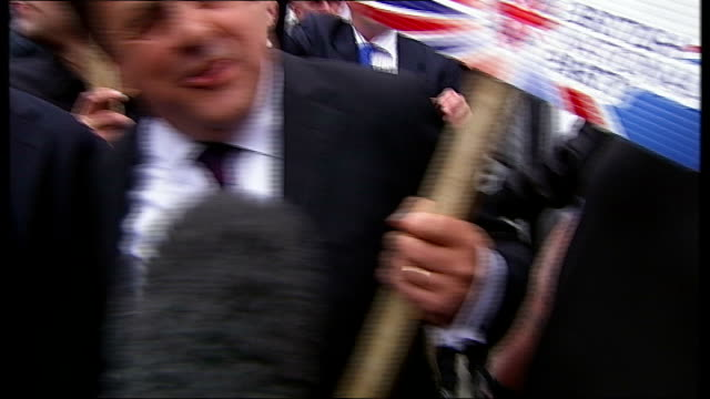 bnp and antifascists protests nick griffin arriving with 'hate preachers out' placard nick griffin interview sot griffin surrounded by press and... - griffin stock videos & royalty-free footage