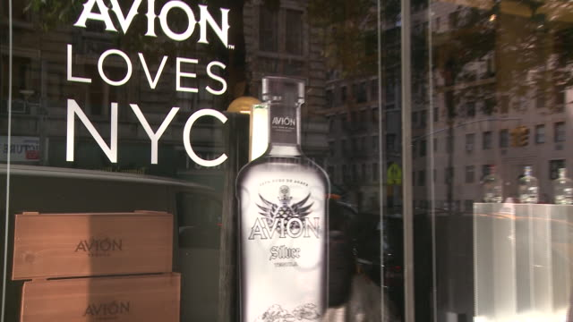 and avion tequila display in a liquor store window - avion stock-videos und b-roll-filmmaterial