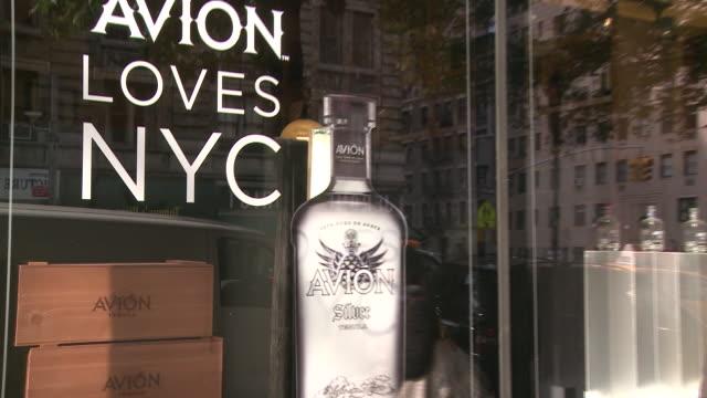 stockvideo's en b-roll-footage met and avion tequila display in a liquor store window - avion