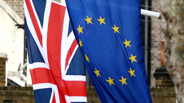 eu and british flags are seen near downing street on march 13 2017 in london england article 50 will be triggered on march 29 and the process that... - british flag stock videos and b-roll footage