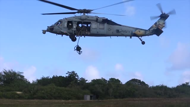 us and british royal marines conduct fast rope insertion training in guam - guam stock videos and b-roll footage