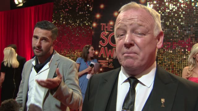 interview and broll coronation street actor and comedian les dennis talks about his new character's role at the british soap awards 2014 - ソープオペラ点の映像素材/bロール