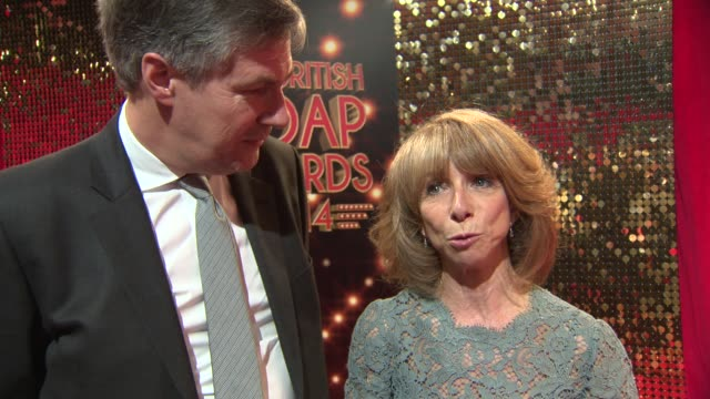 interview and broll coronation street actress helen worth stands with her husband trevor dawson as she talks to the press at the british soap awards... - コロネーションストリート点の映像素材/bロール