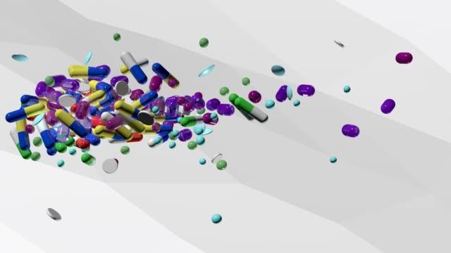 vídeos de stock e filmes b-roll de pills and capsules - vitamina a