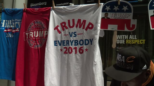 wgn dnc and donald trump merchandise for sale near the quicken loans arena during the republican national convention in cleveland ohio on july 21 2016 - republican national convention stock videos & royalty-free footage
