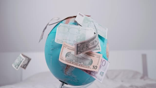 US and Euro currency falling over globe, super slow motion