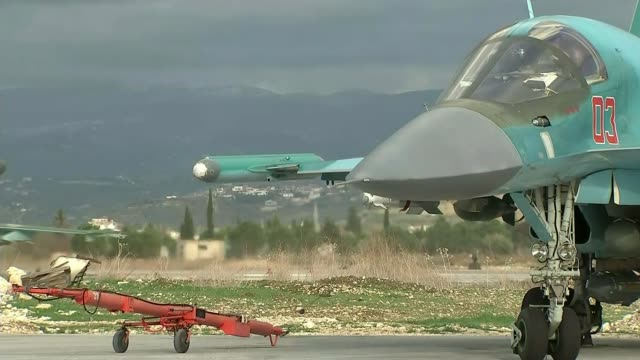 usa uk and france launch military strikes against syria in response to douma chemical attack t20011603 / 2012016 latakia ext russian fighter jet... - 武力攻撃点の映像素材/bロール